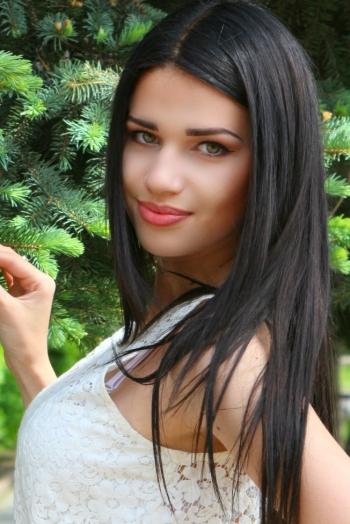 Ukrainian girl Julia,20 years old with green eyes and dark brown hair.
