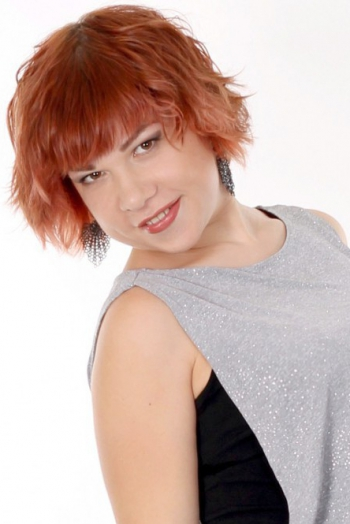 Ukrainian girl Julia,31 years old with brown eyes and red hair.