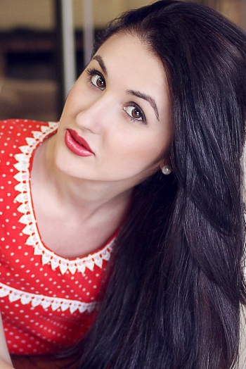 Ukrainian girl Victoria,25 years old with brown eyes and black hair.