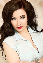Ukrainian girl Karina,20 years old with blue eyes and dark brown hair.
