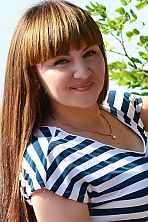Ukrainian girl Karina ,25 years old with blue eyes and dark brown hair.