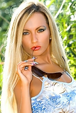 Ukrainian girl Anna,33 years old with blue eyes and blonde hair.