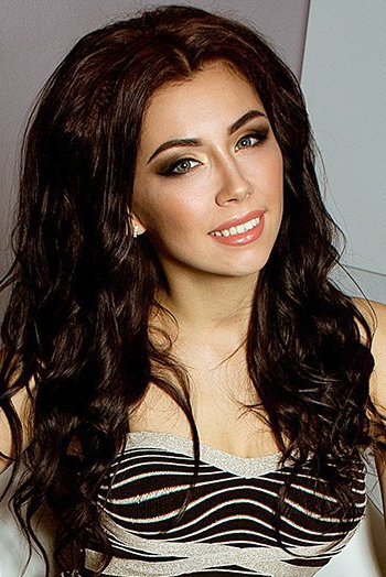 Ukrainian girl Anastasia,29 years old with green eyes and dark brown hair.