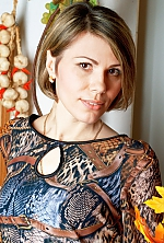 Ukrainian girl Lubov,38 years old with black eyes and light brown hair.