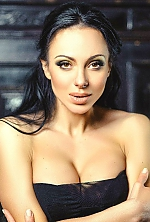 Ukrainian girl Julia,25 years old with green eyes and black hair.