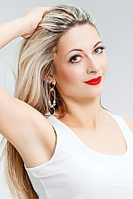 Ukrainian girl Lubov,35 years old with blue eyes and light brown hair.