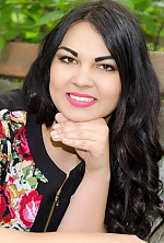 Ukrainian girl Snejana,31 years old with black eyes and black hair.