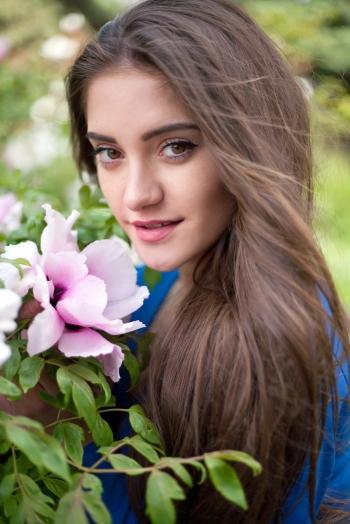 Ukrainian girl Viktoria,21 years old with brown eyes and dark brown hair.