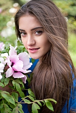 Ukrainian girl Viktoria,21 years old with brown eyes and dark brown hair.