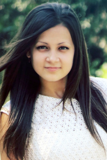 girl Olga , years old with  eyes and  hair.