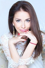 Ukrainian girl Irina,28 years old with blue eyes and dark brown hair.
