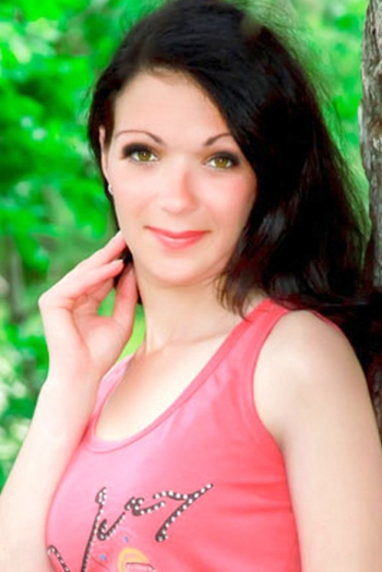 Ukrainian girl Anna,30 years old with green eyes and black hair.