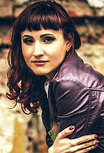 Ukrainian girl Elena,34 years old with green eyes and light brown hair.