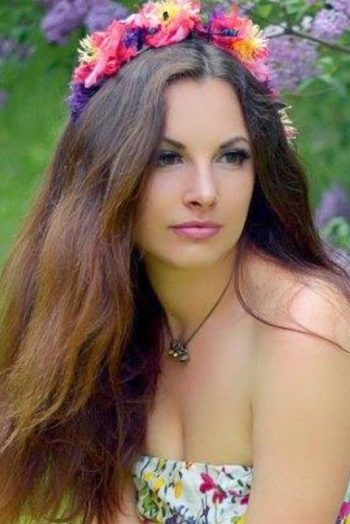 Ukrainian girl Alexandra,32 years old with brown eyes and dark brown hair.