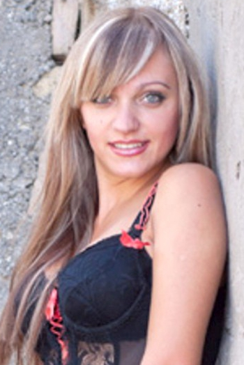Ukrainian girl Katy,28 years old with blue eyes and blonde hair.