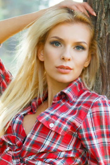 Ukrainian girl Oksana,26 years old with blue eyes and blonde hair.