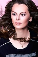 Ukrainian girl Olga,23 years old with black eyes and dark brown hair.