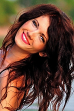 Ukrainian girl Marina,32 years old with brown eyes and dark brown hair.
