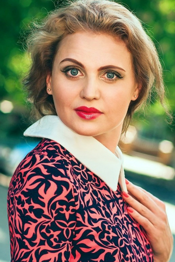 Ukrainian girl Ludmila,46 years old with grey eyes and light brown hair.