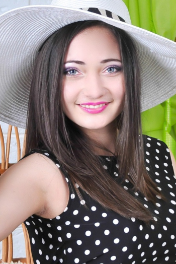 Ukrainian girl Irina,25 years old with green eyes and black hair.
