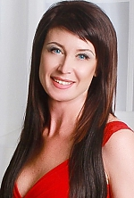 Ukrainian girl Nadezda,45 years old with blue eyes and light brown hair.