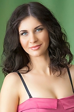 Ukrainian girl Anastasia,26 years old with grey eyes and dark brown hair.